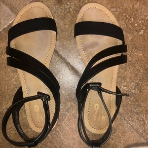 Mix No. 6 black flat sandals with ankle wrap.
